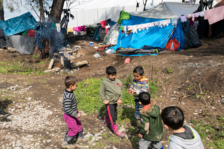 Boys play near their tents on March 17, 2015 in the refugee camp of Idomeni, Greece. For several weeks, more than 10.000 refugees and immigrants wait here for the borders to open. Editorial