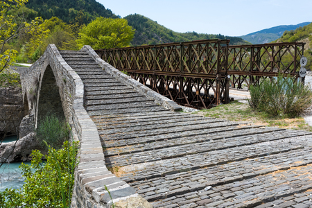 Traditional stone bridge near a Bailey bridge in Western Macedonia, Greece Stock Photo