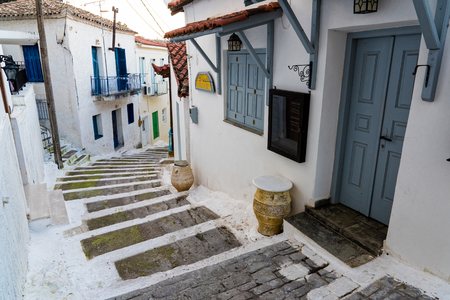 Narrow street with stairs and traditional houses in the old town of Koroni in Peloponnese, Greece Stock Photo