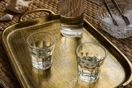 Glasses of traditional drink Ouzo or Raki on bronze dish Stock Photo - 85850700