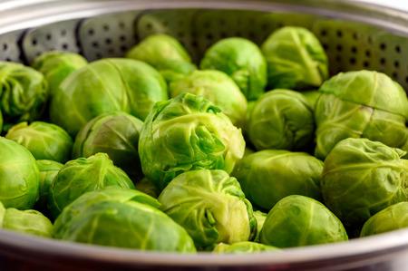 Raw Brussels sprouts in steam cooker Stock Photo