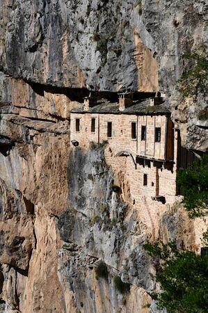 The historic Kipina Monastery (12th century), built on a cliff of the Tzoumerka mountains in Epirus, Greece Фото со стока