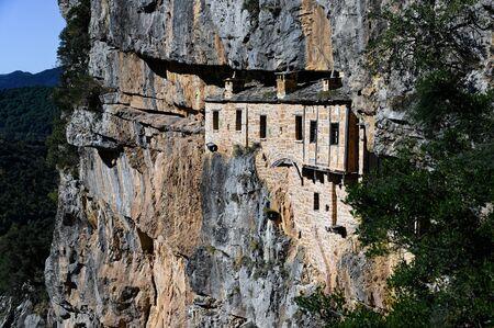 The historic Kipina Monastery (12th century), built on a cliff of the Tzoumerka mountains in Epirus, Greece Stock fotó