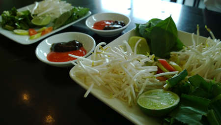 Condiments for beef noodle photo
