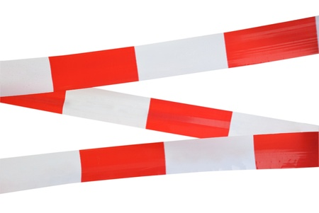 Red and white security striped tape isolated on white photo
