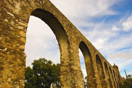 Arches of aqueduct in Evora, Portugal photo
