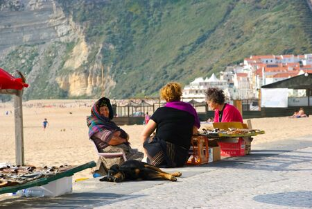 Women selling dried fish, Nazare, Portugal