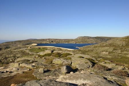 Lake in rocks, Serra da Estrela natural park, Portugal photo