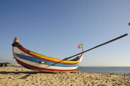 Typical portuguese fishing boat on the beach of Espinho, Portugal