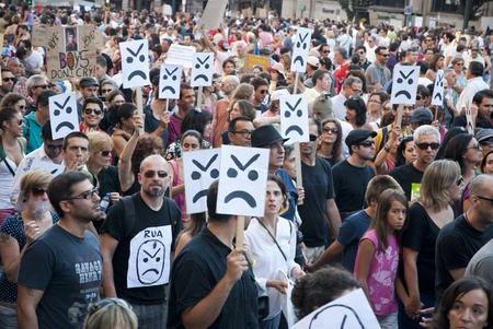 PORTO, PORTUGAL - SEPTEMBER 15: People protesting against government spending cuts and tax rises in Aliados square, Porto on September 15, 2012.