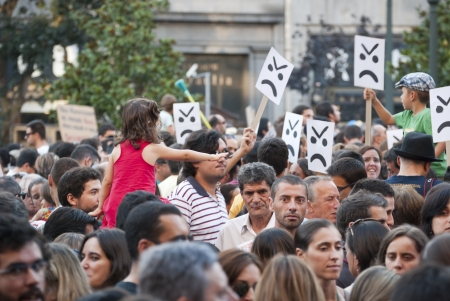 PORTO, PORTUGAL - SEPTEMBER 15: People protesting against government spending cuts and tax rises in Aliados square, Porto on September 15, 2012. Redakční