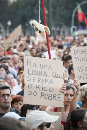 PORTO, PORTUGAL - SEPTEMBER 15: People protesting against government spending cuts and tax rises in Aliados square, Porto on September 15, 2012. Editorial