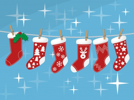 stockings: Christmas socks hanging on rope on blue background