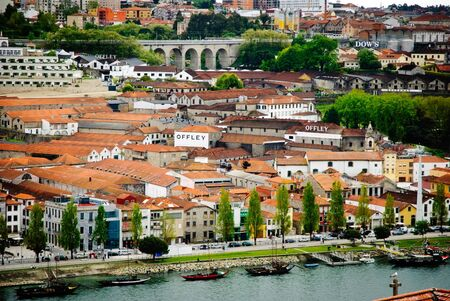 PORTO, PORTUGAL - APRIL 21, 2012 - View towards wine cellars of Porto wine.  Port wine is a Portuguese fortified wine produced exclusively in the Douro Valley and known worldwide.