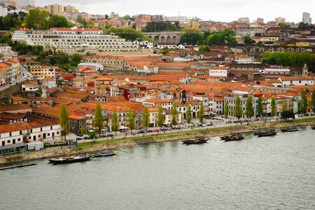 exclusively: PORTO, PORTUGAL - APRIL 21, 2012 - View towards wine cellars of Porto wine.  Port wine is a Portuguese fortified wine produced exclusively in the Douro Valley and known worldwide.