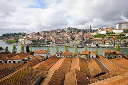 PORTO, PORTUGAL - APRIL 21, 2012 - View towards Porto over the Sandeman wine cellars roofs. Sandeman is one of recognizable Porto Wine companies.