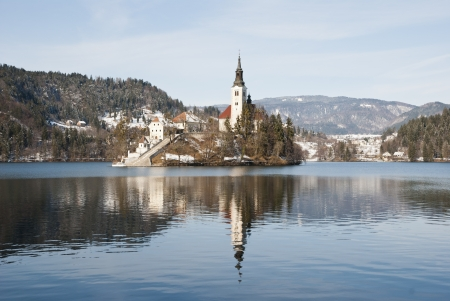 Lake Bled with castle behind in winter, Bled, Slovenia photo
