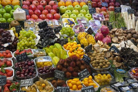 Various colorful fruits and vegetables at market La Boqueria in Barcelona