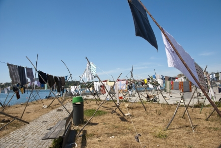 Laundry drying on the rope outside on a sunny day photo