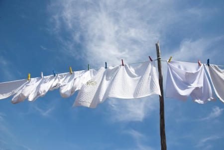 laundry line: Laundry drying on the rope outside on a sunny day Stock Photo