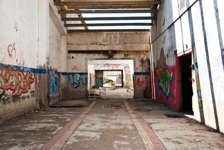 Interior of abandoned factory building, full of graffiti