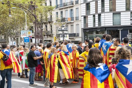 separatism: BARCELONA, SPAIN - SEPTEMBER 11: People joining the human chain Catalan Way crossing all Catalonia, silent demonstration for independent Catalonia in Barcelona, Spain on September 11, 2013 Editorial