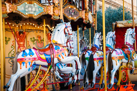 carrousel: Horses at old fashioned french carousel