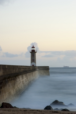 Long exposure of light house in twilinght, Porto, Portugal photo