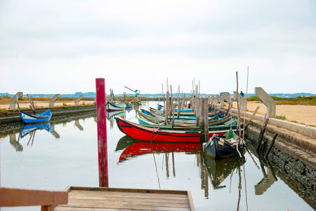 Old boats in water canal of Rio Aveiro, Portugal