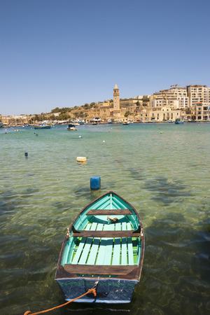 Marsaskala city and bay with typical boats, Malta photo
