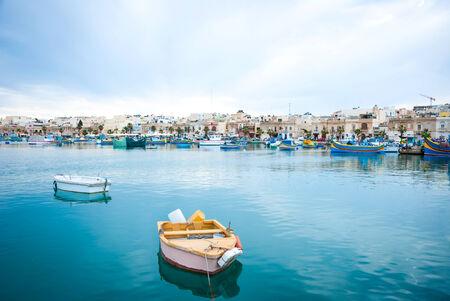 View over Marsaxlokk with boats, Malta photo
