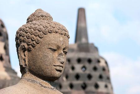 Buddha with stufa detail at Borobudur temple, Yogyakarta, Indonesia photo