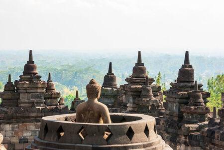 Buhhdist temple Borobudor with buddha and stuffa with view over the landscepe arround,  Yogyakarta, Indonesia photo