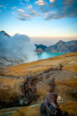 indonesia people: Kawah Ijen volcanic crater with lake at morning dawn, Java, Indonesia Stock Photo