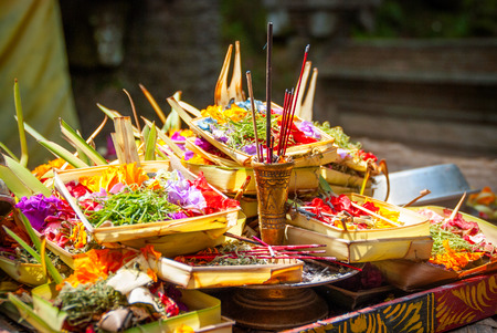 indonesia culture: Hindu offerings and gifts to god in the temple in Bali, Indonesia