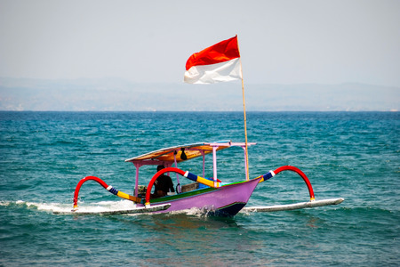 the indonesian flag: Typical indoensian boats called jukung on the beach of Lovina, Bali, Indonesia Stock Photo