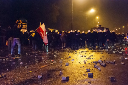 riots: WARSAW, POLAND - NOVEMBER 11: Protests and riots at night during polish Independence day in Warsaw in November 11, 2014 Editorial