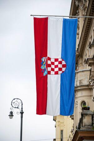 croatian: Croatian flag hanging on the building Stock Photo