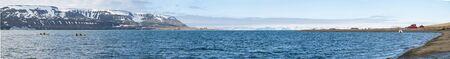 polar environment: Panorama of Longyearbyen fjord with people kayaking, Svalbard