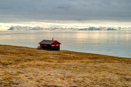 Lonely house at the coast near Longyearbyen, Svalbard, Arctic