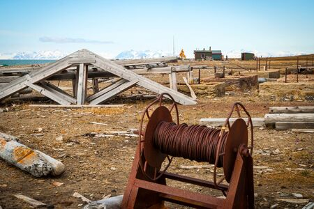 polar station: Old rusted mining equipment on the shore in Svalbard, Norway