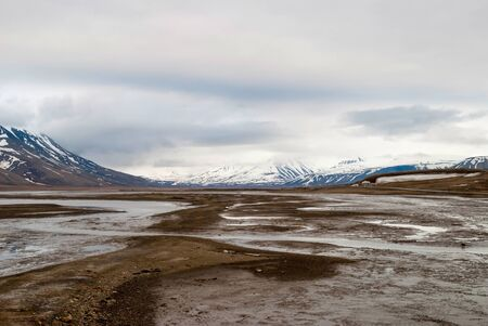 mud snow: Landscape of Arctic tundra in early summer mud, Svalbard Stock Photo
