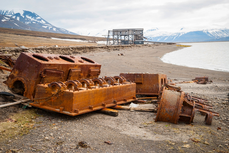 mining equipment: Old rusted mining equipment on the shore in Svalbard, Norway