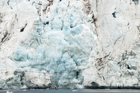 spitsbergen: Close up of blue ice and cracks in the glacier by the arctic sea, Svalbard, Norway
