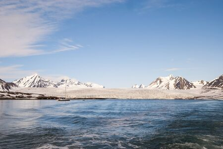 sailingboat: Sailing boat in front of the glacier and mountains in Svalbard, Arctic
