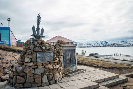 communists: Communistic memorial with anchor in Barentsburg, Svalbard Stock Photo