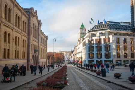 streetlife: OSLO, NORWAY - JANUARY 29: People walking along the street in Oslo downtown in sunny winter day. Taken in Oslo, January 29, 2015.