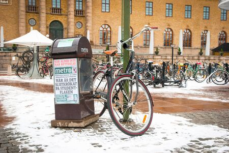 gothenburg: GOTHENBURG, SWEDEN - FEBRUARY 1: Bicycle parked at street lamp in Gothernburg on February 1, 2015