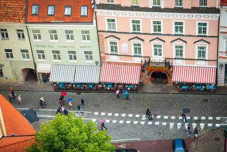 bird view: VILNIUS, LITHUANIA - JULY 12: Bird view to people walking in a street in downtown of Vilnius, Lithuania on July 12, 2015