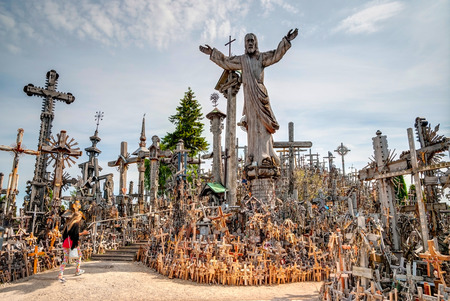 SIAULIAI, LITHUANIA - JULY 18: Pilgrims visiting Hill of crosses (kryziu kalnas) a famous religious landmark in Lithuania on July 18, 2015 Editorial